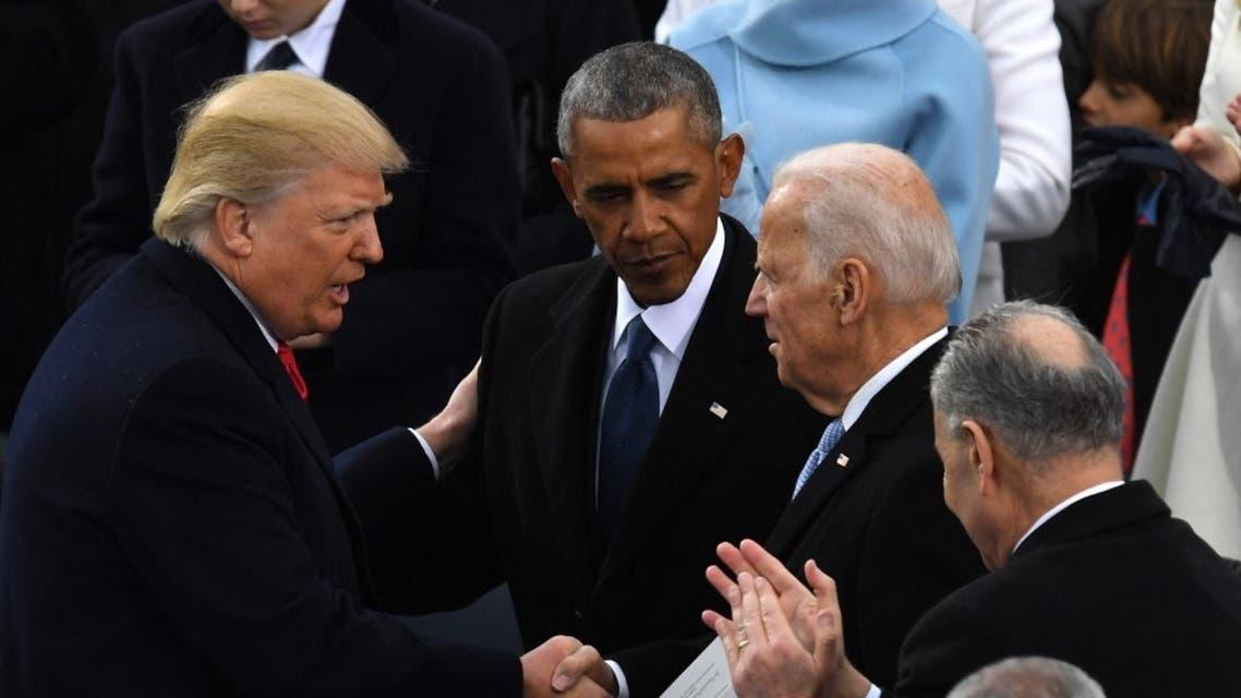 Former US President Donald Trump shakes hands with former US President Barack Obama and then former VP Joe Biden after being sworn in, Jan. 20, 2017. (AFP)