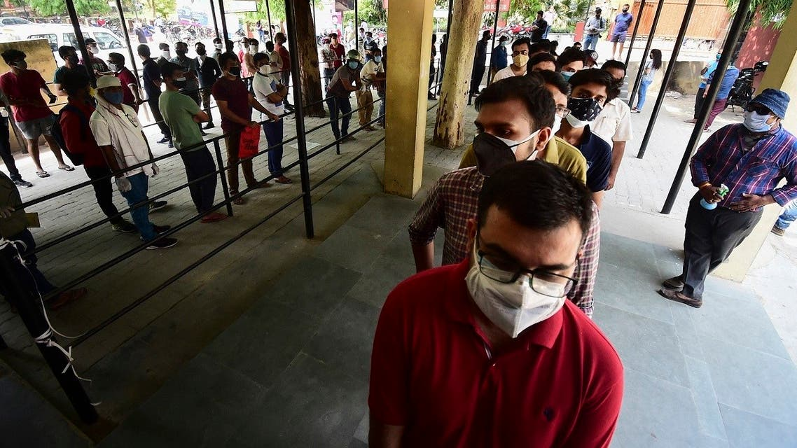 People wait in line to receive a dose of the Covishield coronavirus vaccine, at Tej Bahadur Sapru hospital in Allahabad on May 1, 2021 during the first day of India's vaccination drive to all adults. (Sanjay Kanojia/AFP)People wait in line to receive a dose of the Covishield coronavirus vaccine, at Tej Bahadur Sapru hospital in Allahabad on May 1, 2021 during the first day of India's vaccination drive to all adults. (Sanjay Kanojia/AFP)