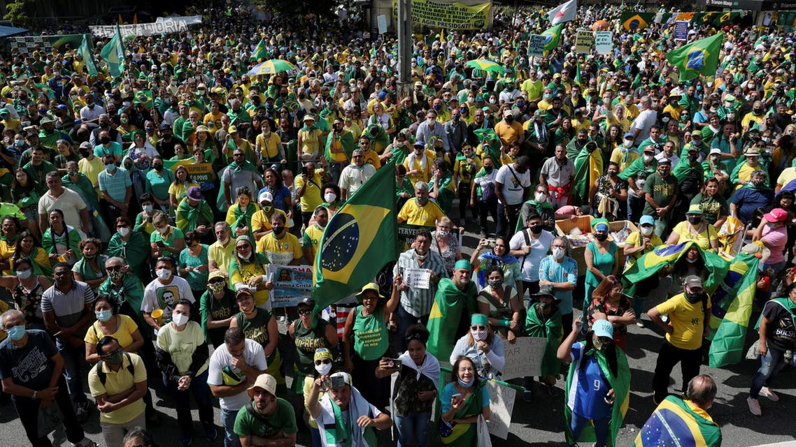 Supporters of Brazilian President Jair Bolsonaro pray as they take part in a protest at Paulista Avenue in Sao Paulo, Brazil, May 1, 2021. REUTERS/Amanda Perobelli