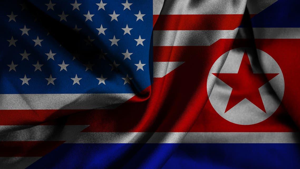 Waving flag of North Korea and USA stock photo