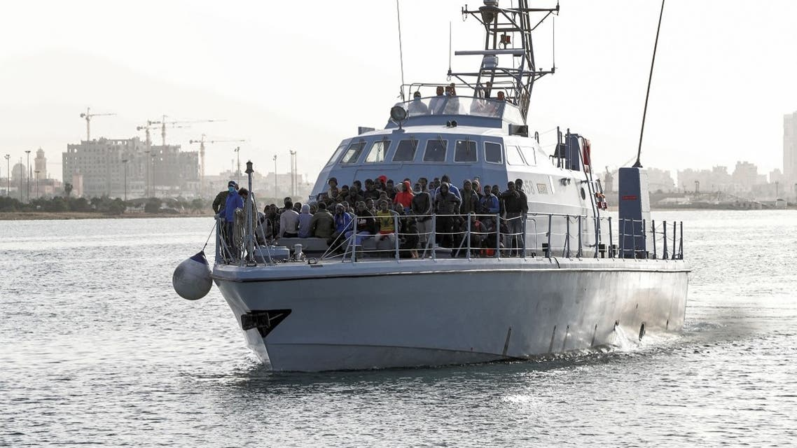 Migrants arrive at the naval base in the Libyan capital of Tripoli on April 29, 2021 after the coastguard intercepted an inflatable boat carrying 99 Europe-bound migrants off its west coast. (Mahmud Turkia/AFP)