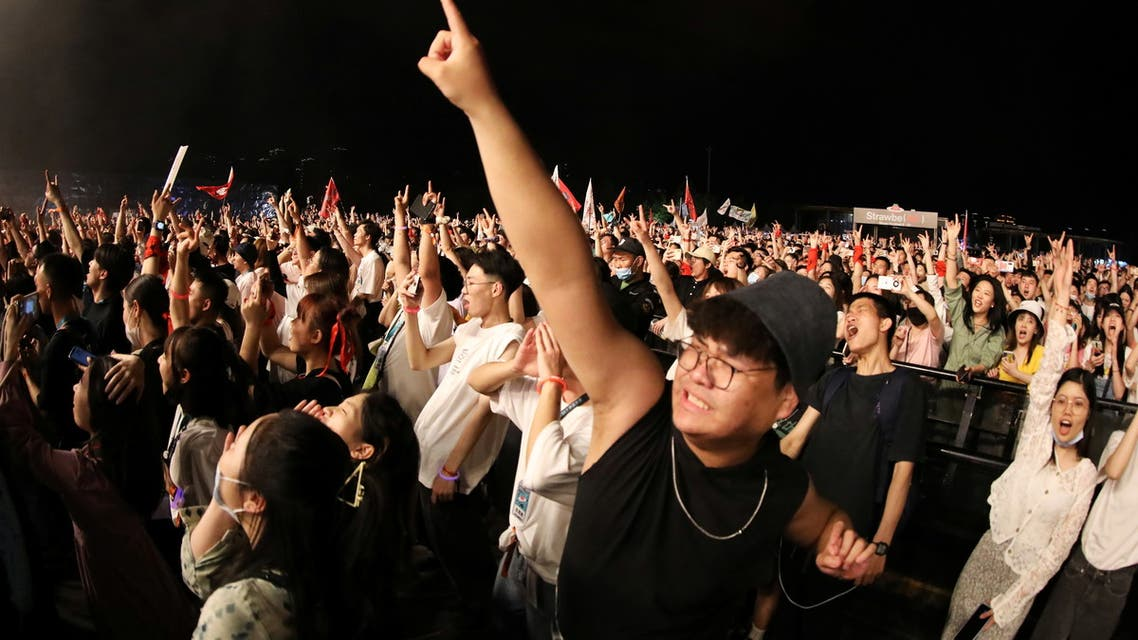 Fans attend a performance of a rock band at the Strawberry Music Festival during Labour Day holiday in Wuhan, Hubei Province, China May 1, 2021. REUTERS/Tingshu Wang