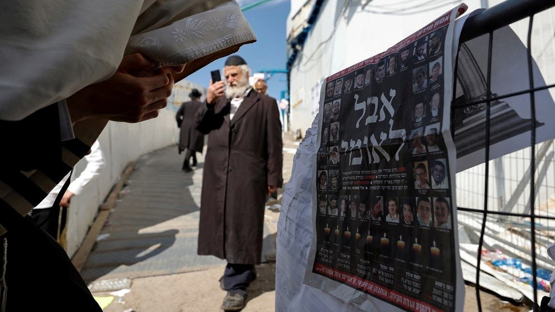 "Ultra-Orthodox Jewish man reacts in front of a newspaper's front page with the Hebrew words ""National Mourning,"" at the site of the religious festival at Mount Meron, Israel May 2, 2021. (Reuters/Amir Cohen)"