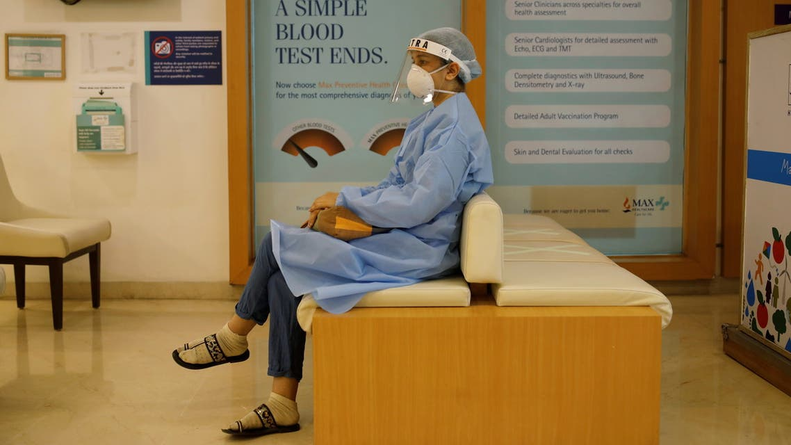 A woman waits to be vaccinated for the coronavirus disease (COVID-19) at a hospital, in New Delhi, India, May 1, 2021. REUTERS/Adnan Abidi