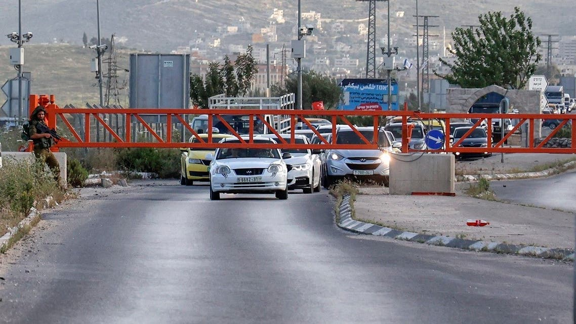 Israeli soldiers stand guard after closing the entrance of Nablus city in the occupied West Bank, on May 2, 2021, following a reported attack. (Jaafar Ashtiyeh /AFP)