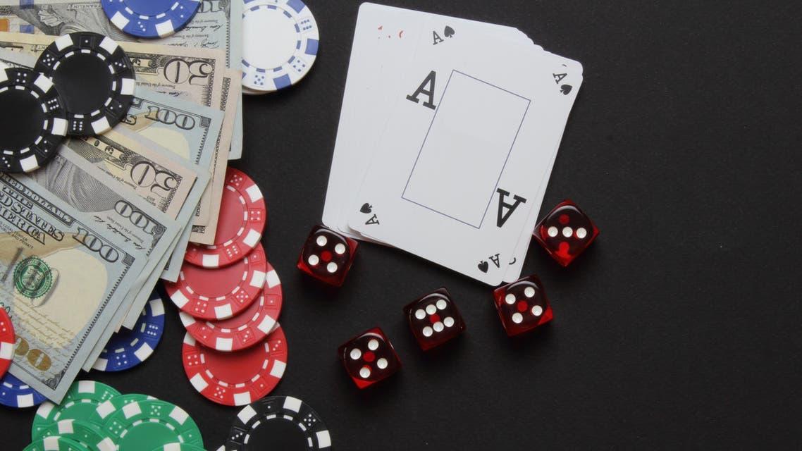 Casino chips, dice and money stock photo