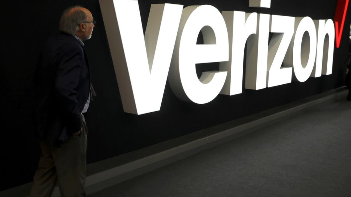 FILE PHOTO: A man stands next to the logo of Verizon at the Mobile World Congress in Barcelona, Spain, February 26, 2019. (File Photo: Reuters)