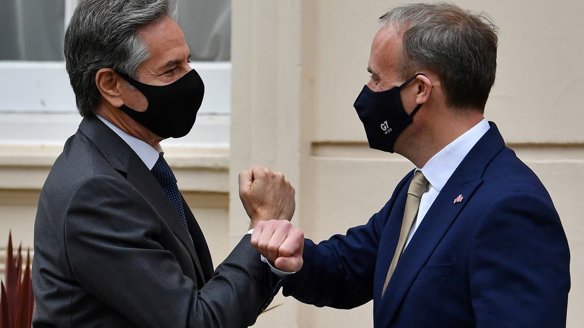 Britain's Foreign Secretary Dominic Raab (R) greets U.S. Secretary of State Antony Blinken by tapping arms with him as he arrives for their bilateral meeting in London, Britain May 3, 2021 during the G7 foreign ministers meeting. (Reuters)