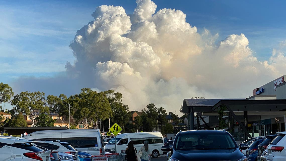 This picture taken on May 2, 2021 shows smoke filling the sky as Sydney is enveloped in a thick bank of hazardous bushfire smoke forcing authorities in Australia's largest city to scale back controlled forest burning nearby.