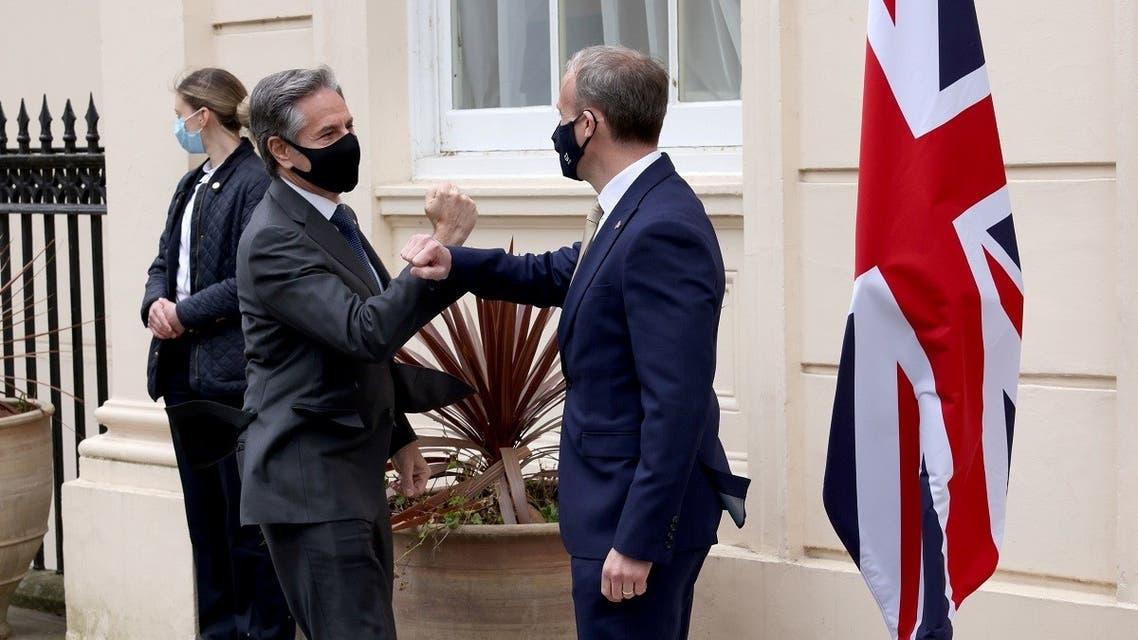 UK Foreign Secretary Dominic Raab greets US Secretary of State Antony Blinken in London, May 3, 2021. (Reuters)