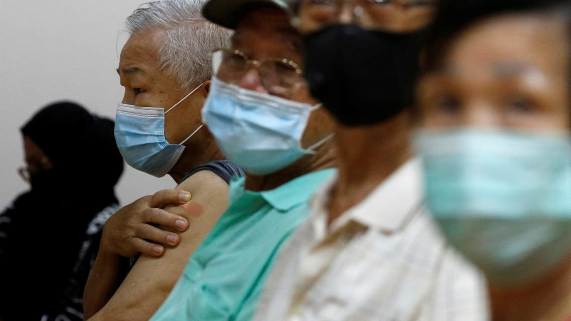 People wait at an observation area after their vaccination at a coronavirus disease (COVID-19) vaccination center in Singapore March 8, 2021. (Reuters)