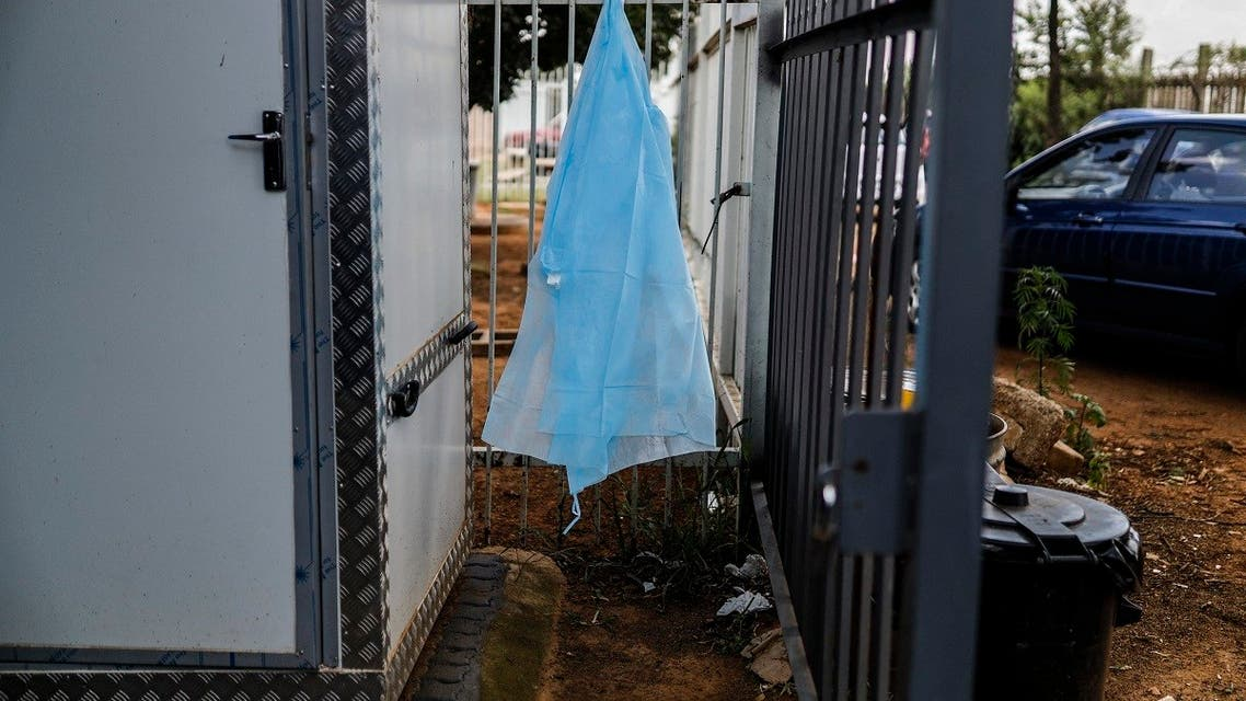 Personal protective equipment (PPE) hangs outside the COVID-19 ward number 20 at the Tembisa Hospital in Tembisa, on March 2, 2021. (Guillem Sartorio/AFP)
