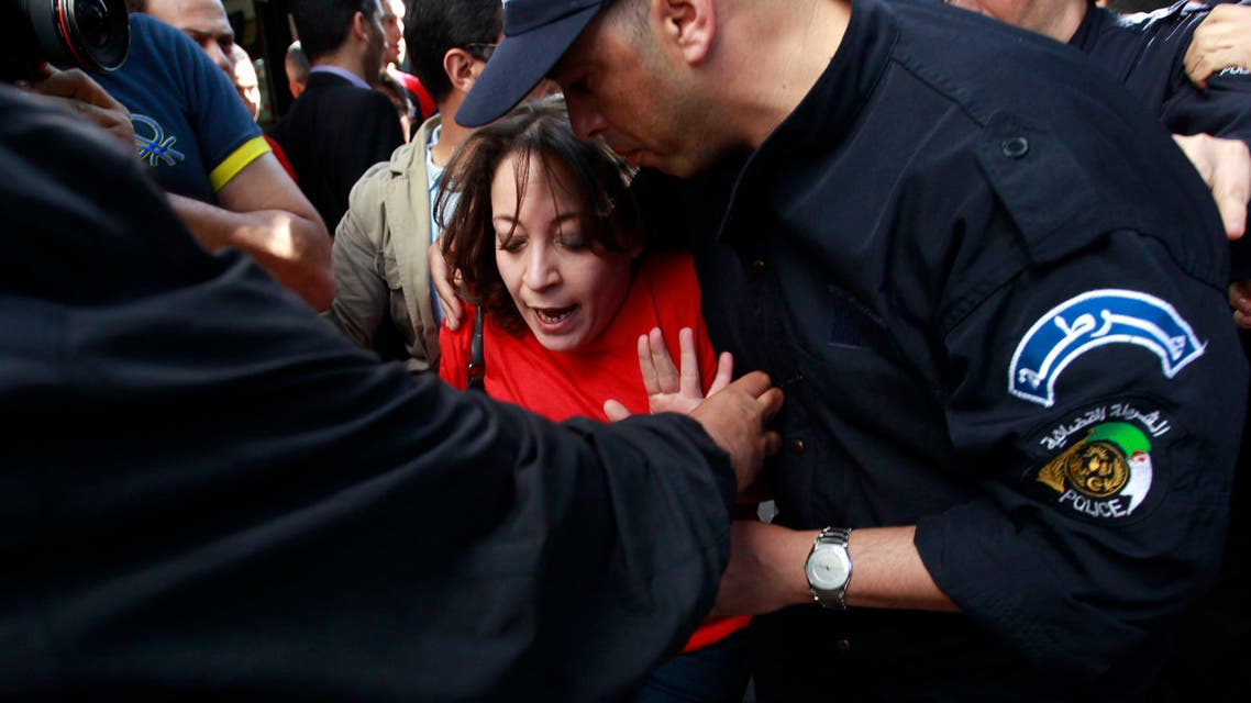 Police officers detain Amira Bouraoui leader of the Barakat (Enough) movement during a demonstration against election and Algerian President Abdulaziz Bouteflika's decision to run for a fourth term, in Algiers April 16, 2014. (Reuters)