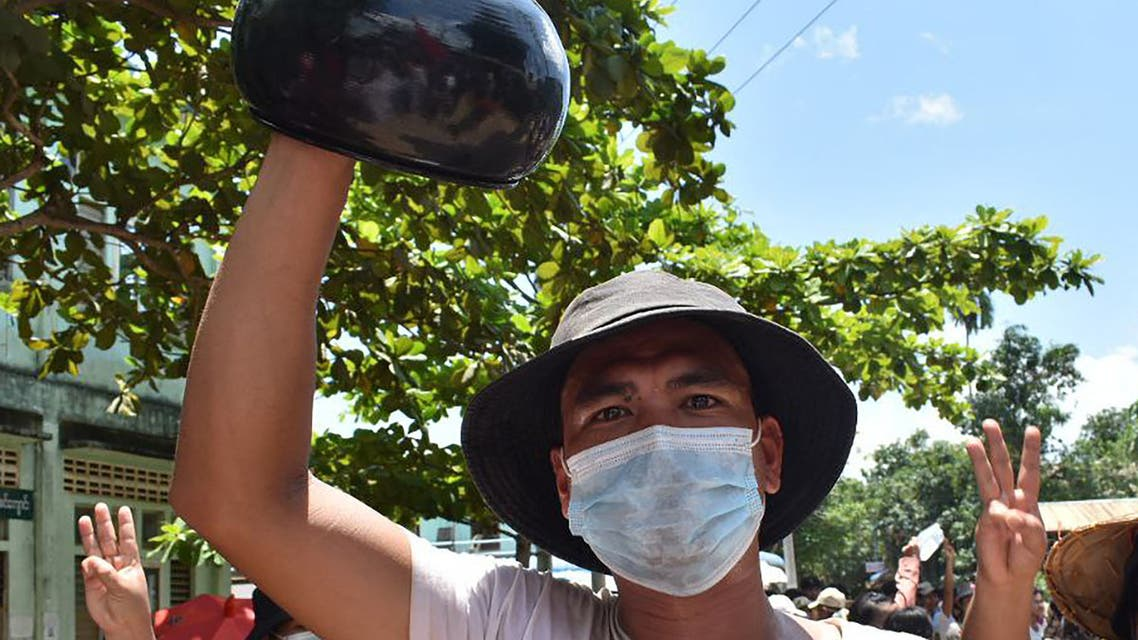 This handout photo taken and released by Dawei Watch on May 2, 2021 shows a protester holding an overturned alms bowl while taking part in a demonstration against the military coup on Global Myanmar Spring Revolution Day in Dawei. (File photo: AFP)