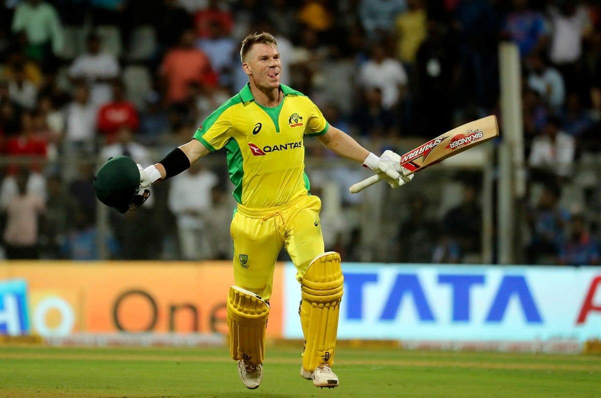 Australia's David Warner celebrates after scoring a hundred during the first one-day international cricket match between India and Australia in Mumbai, India. (Reuters)