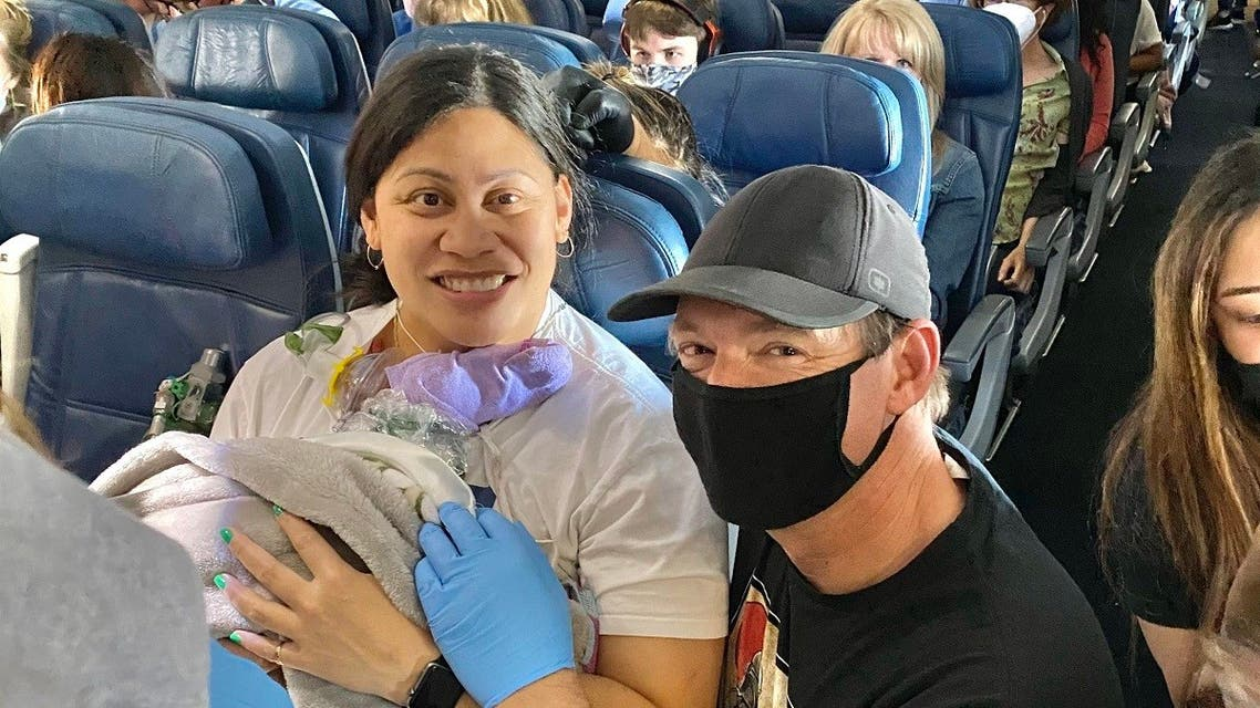 A doctor and a team of neonatal medical professionals help a pregnant woman deliver her baby mid-flight. (Twitter)