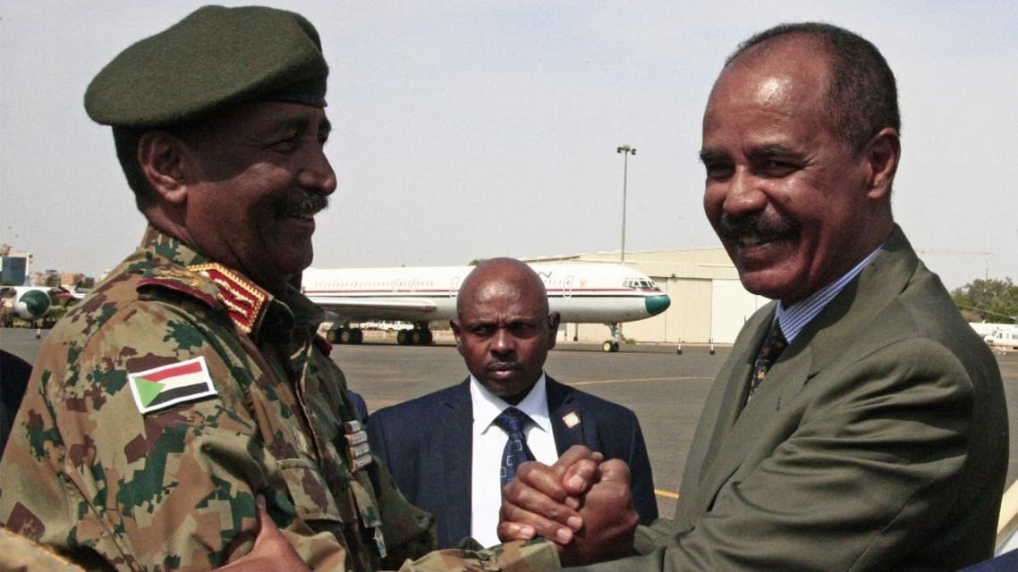 President of the Sudanese Transitional Council General Abdel Fattah al-Burhan (L) shakes hands with Eritrean President Isaias Afwerki at Khartoum International Airport outside the Sudanese capital September 14, 2019. (AFP)