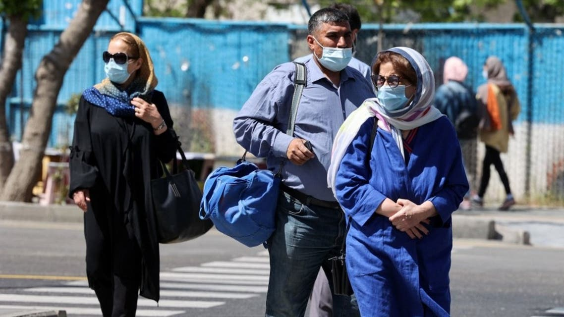 Iranians wearing potective masks go about their day in the capital Tehran, on April 12, 2021. (AFP)