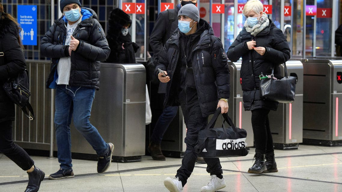 Passengers wearing protective masks enter an underground railway station, amid the spread of the coronavirus disease (COVID-19) pandemic, in Stockholm, Sweden, January 7, 2021. (File Photo: Reuters)