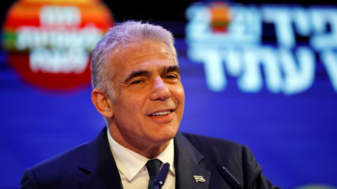 Yesh Atid party leader Yair Lapid delivers a speech following the announcement of exit polls in Israel's general election at his party headquarters in Tel Aviv, Israel March 24, 2021. (Reuters)