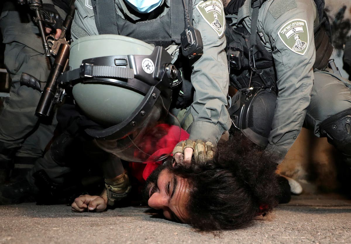 A Palestinian protester is detained by Israeli border policemen during clashes in the Sheikh Jarrah neighborhood of east Jerusalem May 4, 2021. (Reuters)
