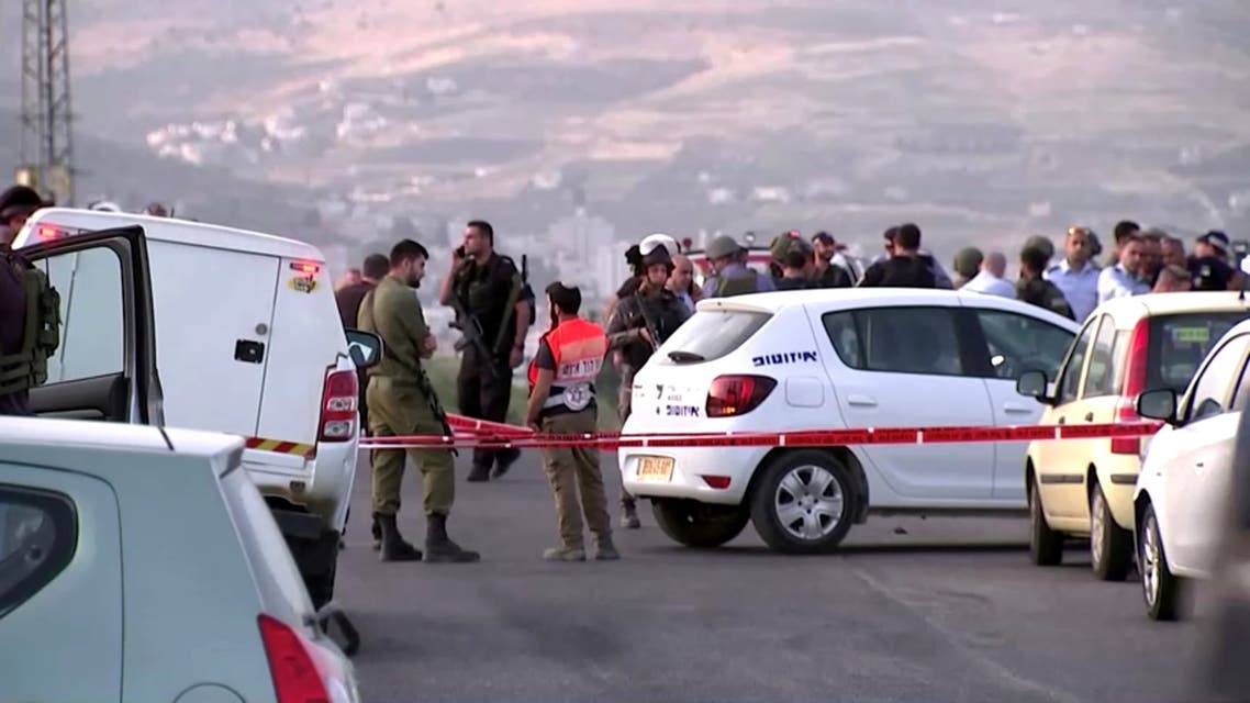 Members of Israeli forces gather at the scene of a shooting incident in the Israeli-occupied West Bank May 2, 2021, in this still image taken from a video. (File photo: Reuters)
