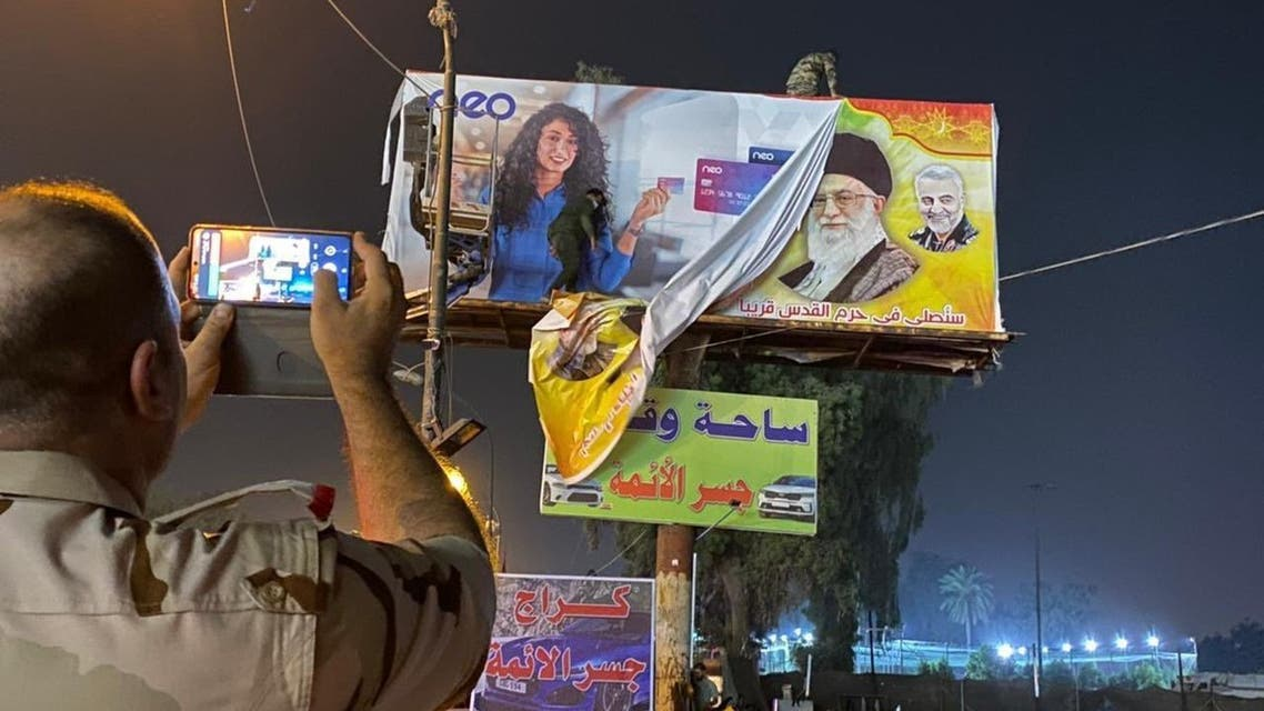 Residents in Baghdad have been captured on camera cheering after billboards of Iran's former and top leaders were torn down in the Iraqi capital. (Via Twitter)