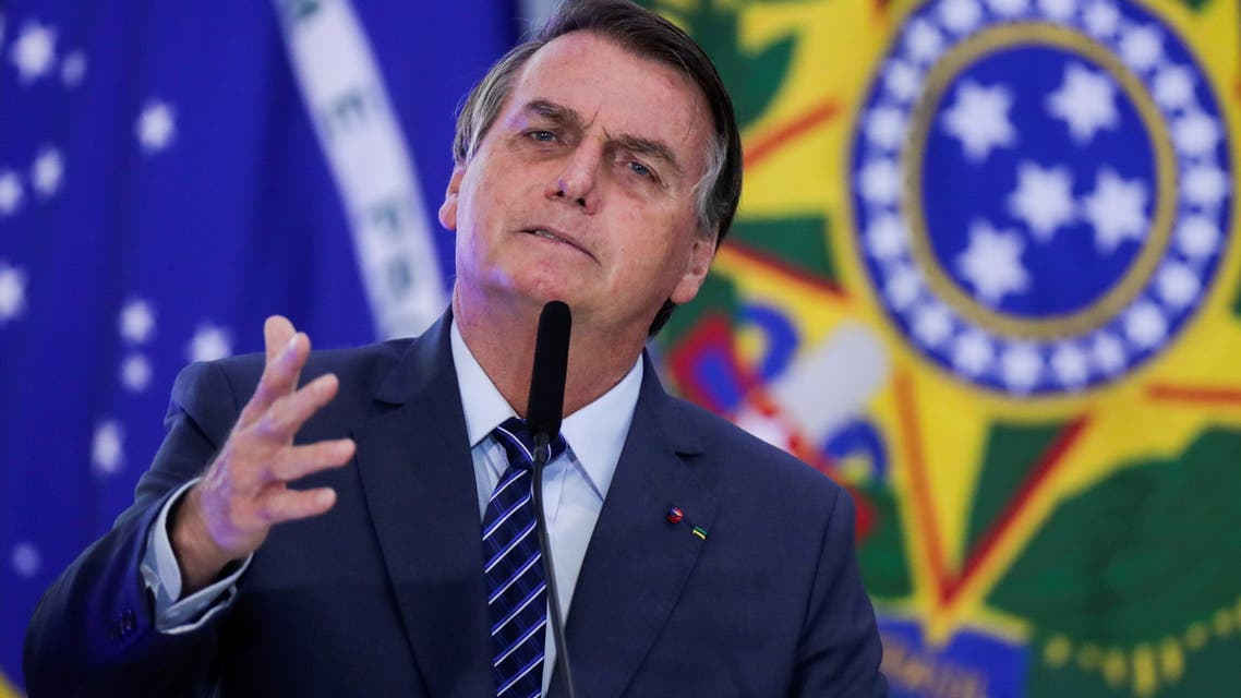 Brazil's President Jair Bolsonaro speaks during the opening ceremony of the Communications Week at the Planalto Palace in Brasilia, Brazil May 5, 2021. REUTERS/Ueslei Marcelino