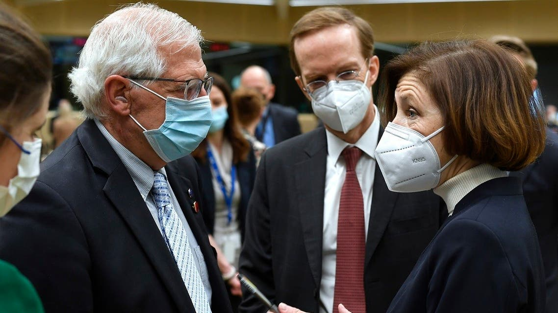 European Union foreign policy chief Josep Borrell (left), speaks with French Defense Minister Florence Parly, right, during a meeting of EU defense ministers at the European Council building in Brussels, on May 6, 2021. (AP)