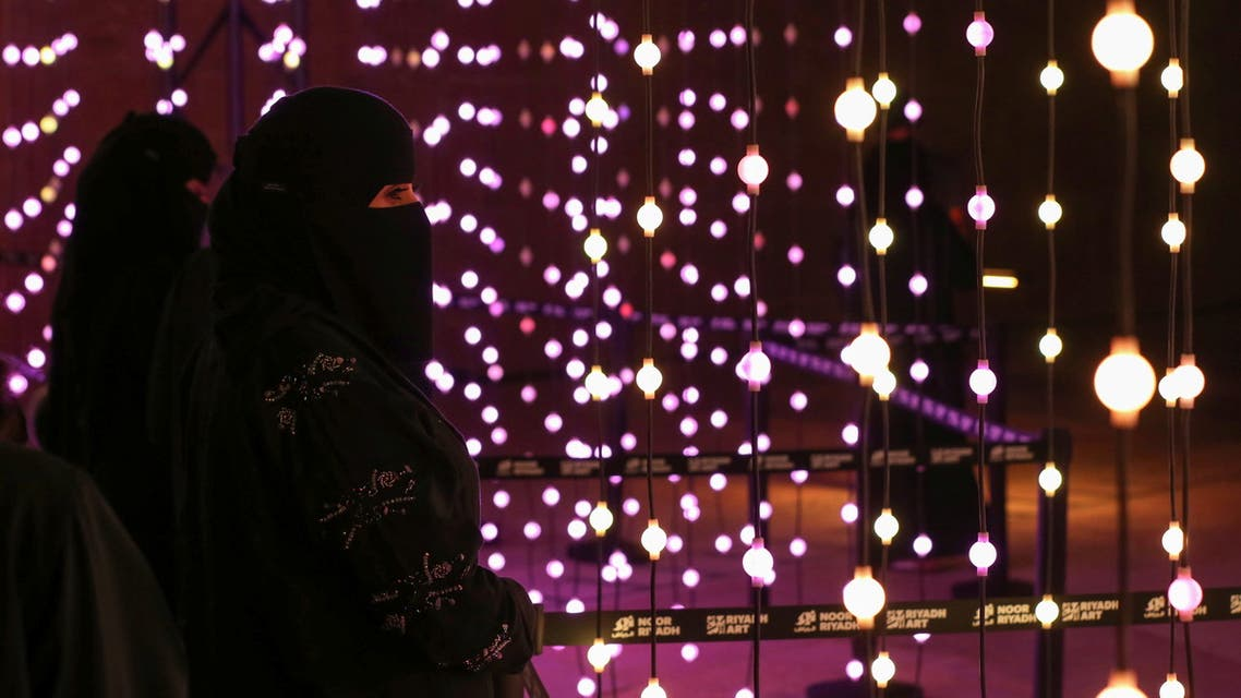 A visitor looks on during 'Noor Riyadh' festival of light, in Riyadh, Saudi Arabia March 19, 2021. Picture taken March 19, 2021. REUTERS/Ahmed Yosri
