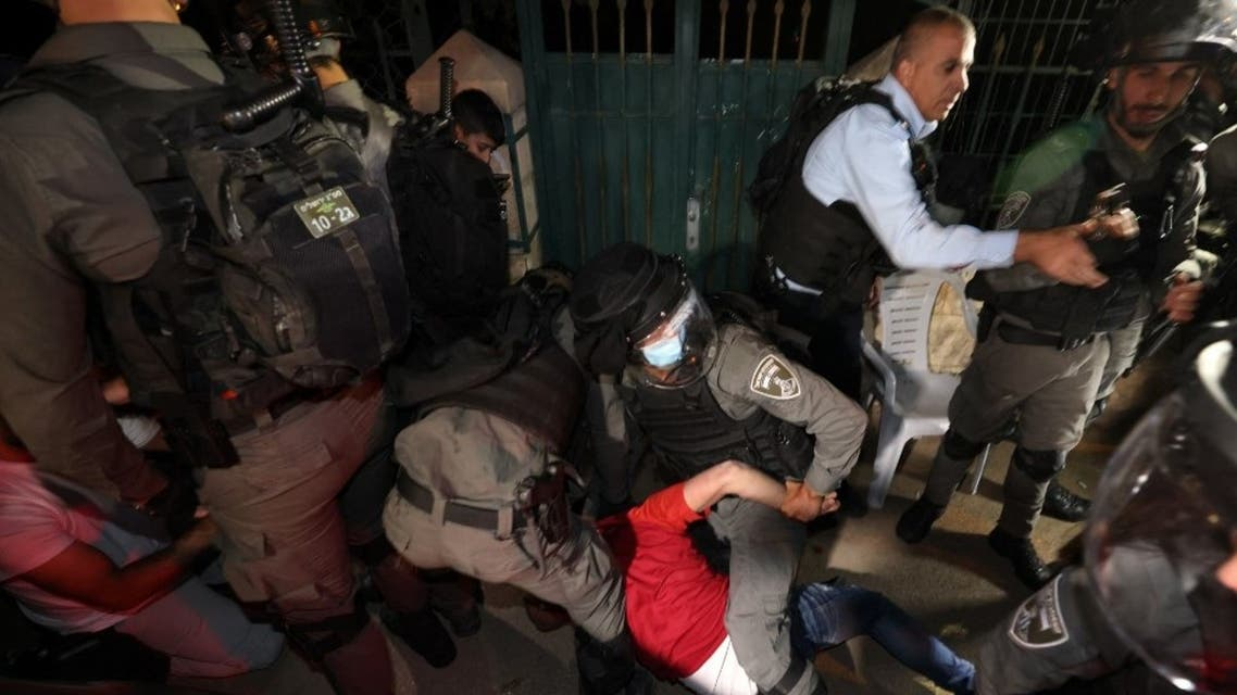 A Palestinian protester is arrested by Israeli security forces, during a demonstration as Palestinian families face eviction, part of an ongoing effort by Jewish Israelis to take control of homes in the Sheikh Jarrah neighbourhood of occupied east Jerusalem, on May 5, 2021. (AFP)