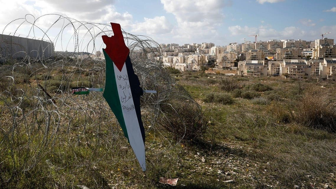 A representation of a map with the colors of the Palestinian flag in the village of Bilin in the Israeli-occupied West Bank, Jan. 31, 2020. (Reuters)