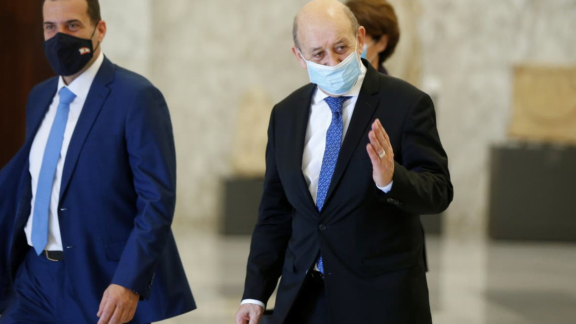 French Foreign Minister Jean-Yves Le Drian walks after a meeting with Lebanon's President Michel Aoun at the presidential palace in Baabda, Lebanon May 6, 2021. (Reuters)