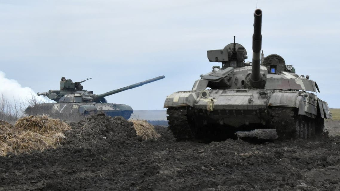 Tanks of the Ukrainian Armed Forces are seen during drills at an unknown location near the border of Russian-annexed Crimea, Ukraine, in this handout picture released by the General Staff of the Armed Forces of Ukraine press service April 14, 2021. Press Service General Staff of the Armed Forces of Ukraine/Handout via REUTERS ATTENTION EDITORS - THIS IMAGE HAS BEEN SUPPLIED BY A THIRD PARTY.