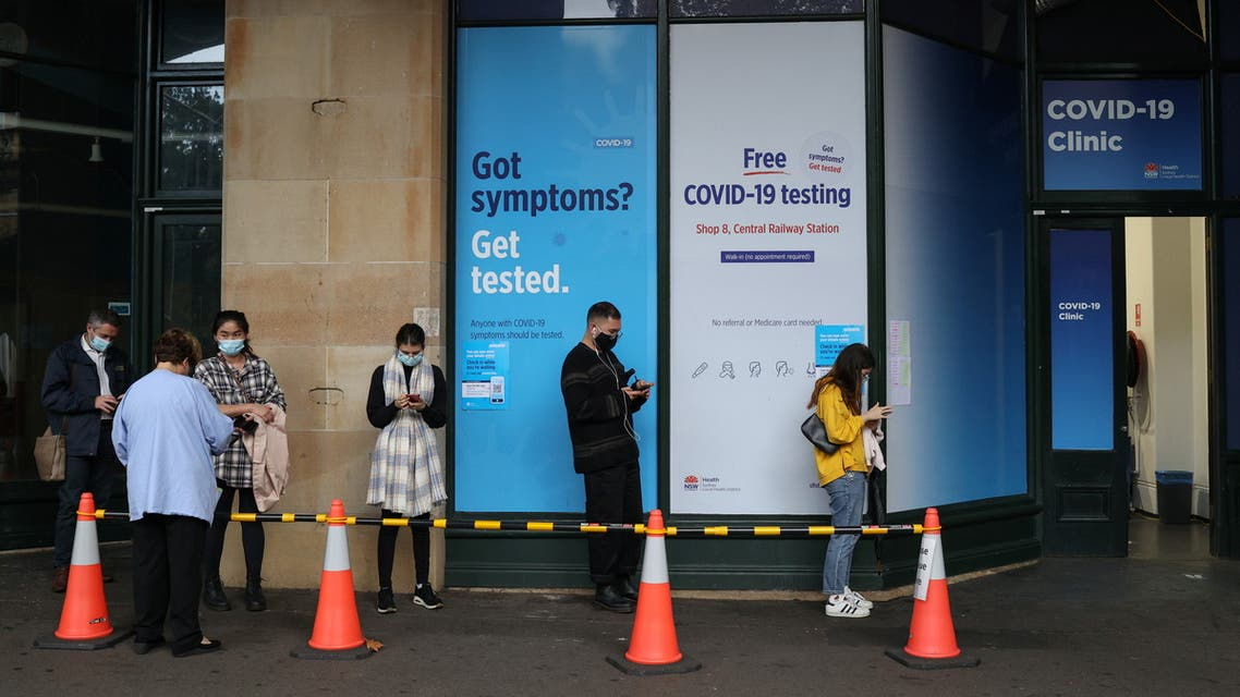People wait in line at a coronavirus disease (COVID-19) testing clinic in the city centre after new cases were reported in Sydney, Australia, May 6, 2021. REUTERS/Loren Elliott