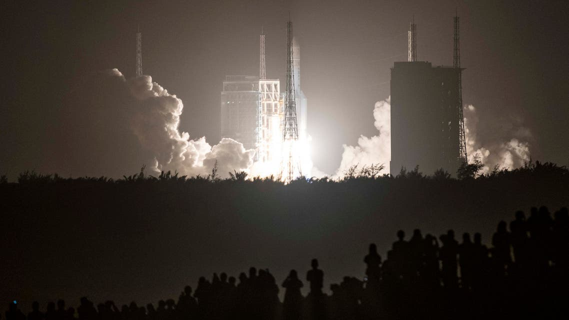In this file photo a Long March 5B rocket carrying China's Chang'e-5 lunar probe launches from the Wenchang Space Center on China's southern Hainan Island on November 24, 2020, on a mission to bring back lunar rocks, the first attempt by any nation to retrieve samples from the moon in four decades. (File photo: AFP)