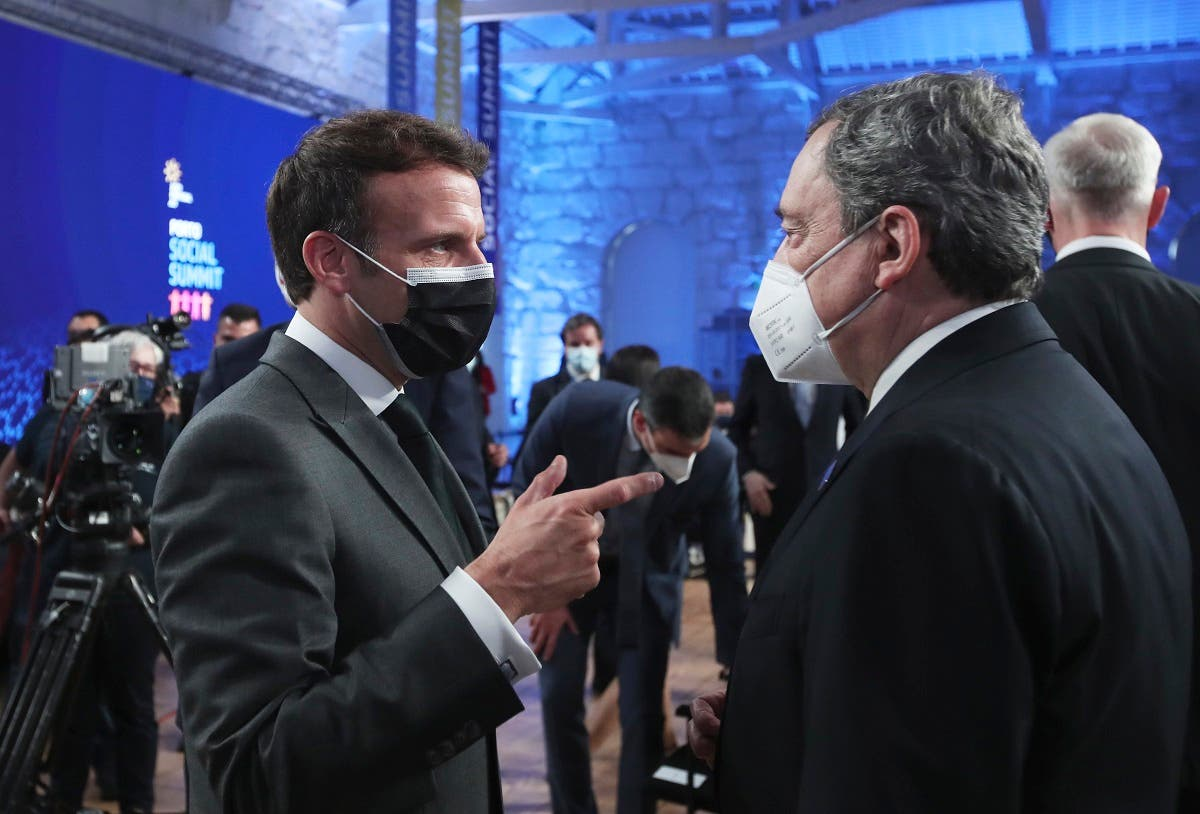 French President Emmanuel Macron, left, speaks with Italy's Prime Minister Mario Draghi during the opening ceremony of an EU summit at the Alfandega do Porto Congress Center in Porto, Portugal, on May 7, 2021. (AP)