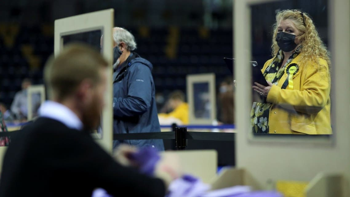Election observers watch as votes are counted for the Scottish Parliamentary election, at a counting centre in Glasgow, Scotland, Britain, on May 7, 2021. (Reuters)