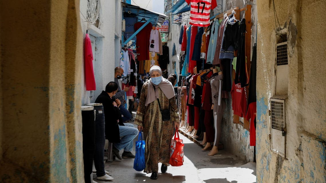 A woman wearing a protective face mask walks in the Medina, in the old city of Tunis, amid the coronavirus disease (COVID-19) outbreak, Tunisia, April 29, 2021. (Reuters)