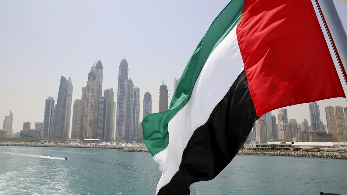 UAE flag flies over a boat at Dubai Marina, Dubai, United Arab Emirates May 22, 2015. (File Photo: Reuters)