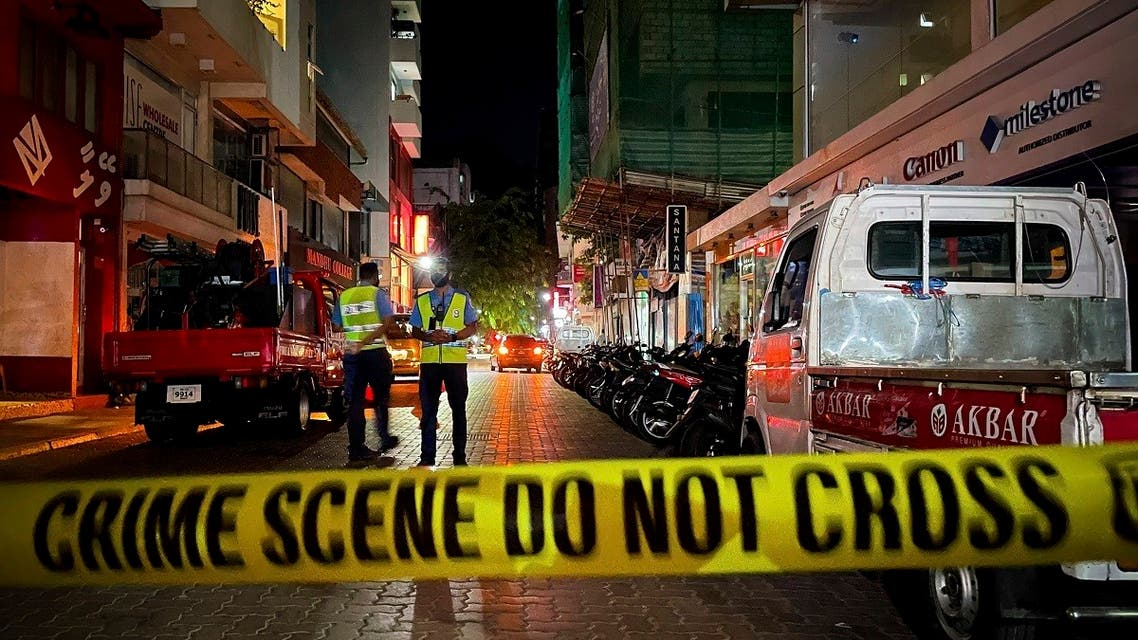 Maldivian police officers secure the area following a blast in Male, Maldives, on May 6, 2021.  (AP)
