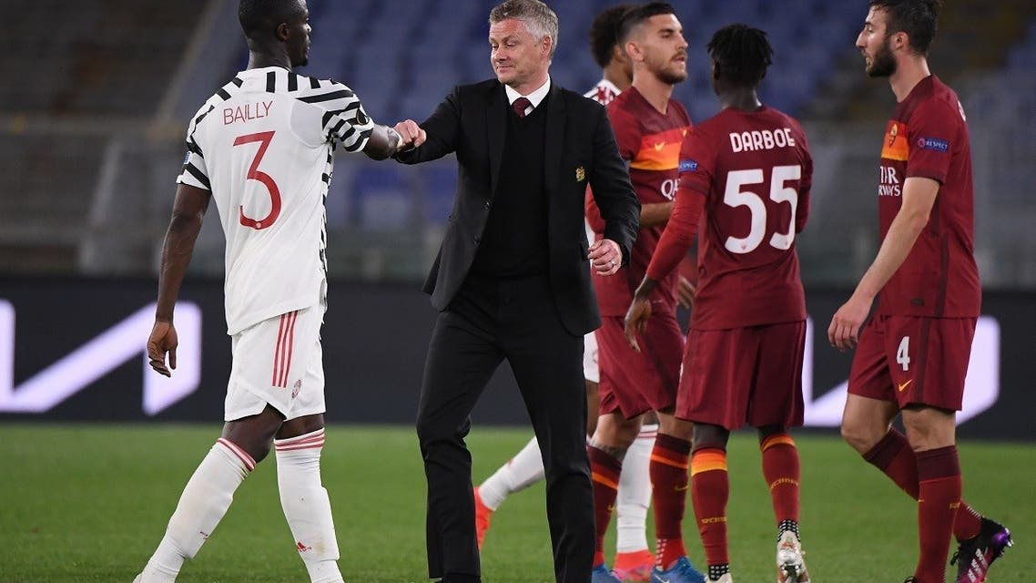 Manchester United manager Ole Gunnar Solskjaer shakes hands with Eric Bailly after the match, May 6, 2021. (Reuters)