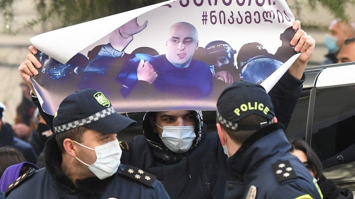 Georgian anti-government protesters picket the parliament building to demand snap polls and the liberation of jailed opposition leader Nika Melia in central Tbilisi on March 2, 2021. (Vano Shlamov/AFP)