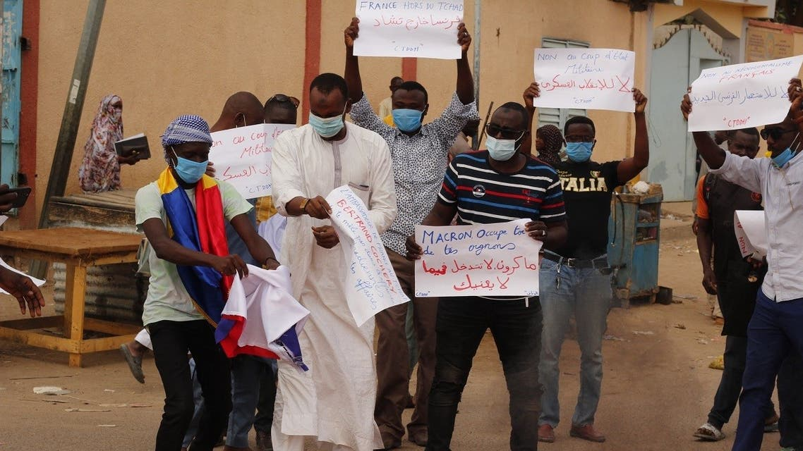 Chadian demonstrators carry banners with anti France slogans as they demonstrate in Ndjamena on May 8, 2021. (Djimet Wiche/AFP)