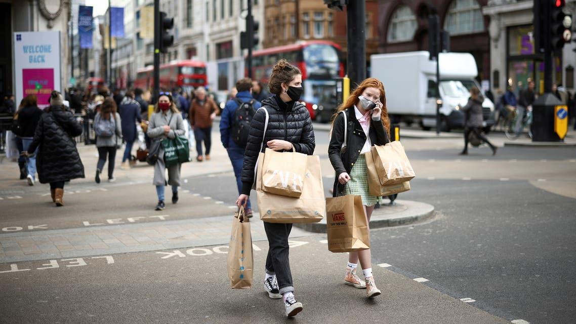 People walk at Oxford Street, as the coronavirus disease (COVID-19) restrictions ease, in London, Britain. (Reuters)
