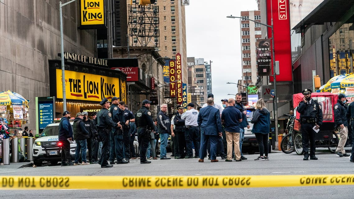 New York City police officers stand guard after a shooting incident in Times Square, New York, US, May 8, 2021. (Reuters)