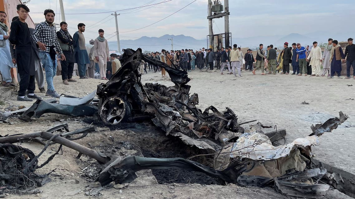 People stand at the site of a blast in Kabul, Afghanistan May 8, 2021. (Reuters)
