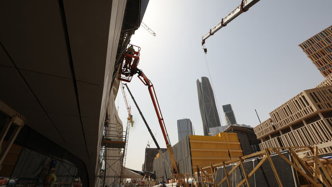 Laborers work on the exterior of the King Abdullah Financial District station during an exclusive tour of the Riyadh Metro on April 1, 2021 in the Saudi capital. (AFP)