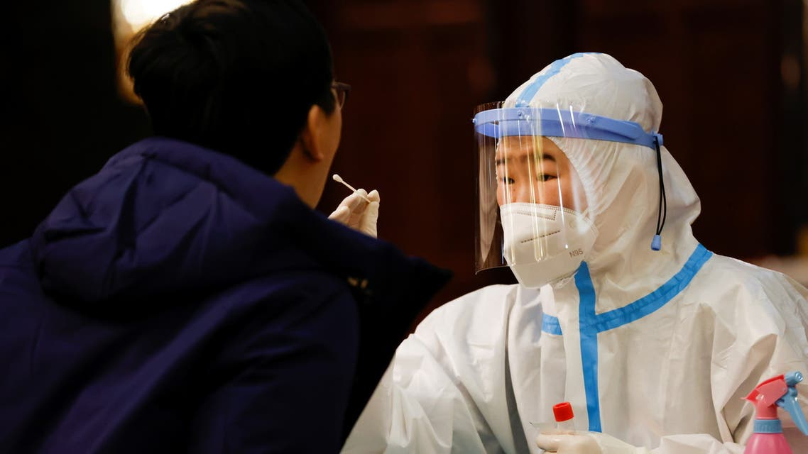 A member of the media gets tested for the coronavirus disease (COVID-19) ahead of the opening session of the Chinese People's Political Consultative Conference (CPPCC) in Beijing, China, March 4, 2021. (File photo: Reuters)
