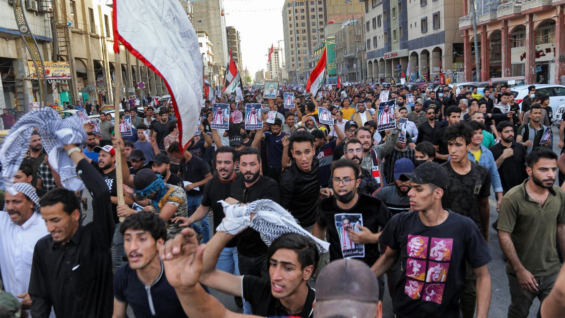 Mourners chant slogans as they march during a funerary procession for renowned Iraqi anti-government activist Ihab al-Wazni (Ehab al-Ouazni) in the central holy shrine city of Karbala on May 9, 2021 following his assassination. (AFP)